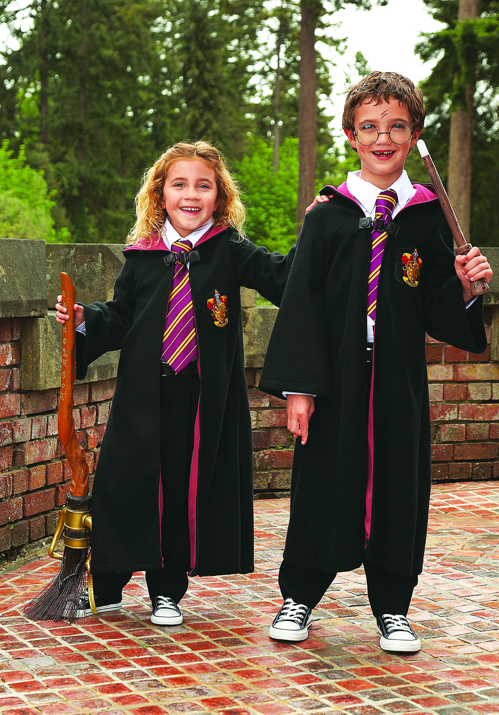 Two kids in Harry Potter and Hermoine Halloween costumes.