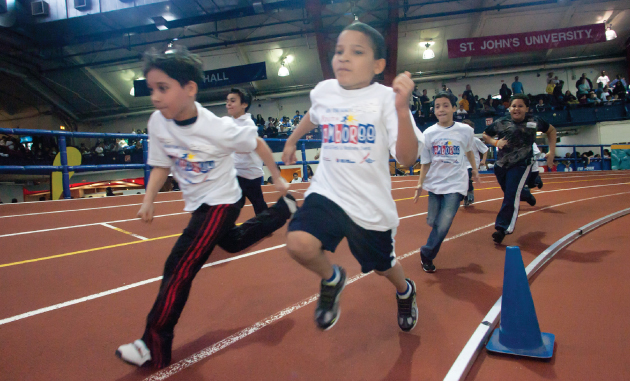 kids run track at the nyrr youth jamboree in nyc