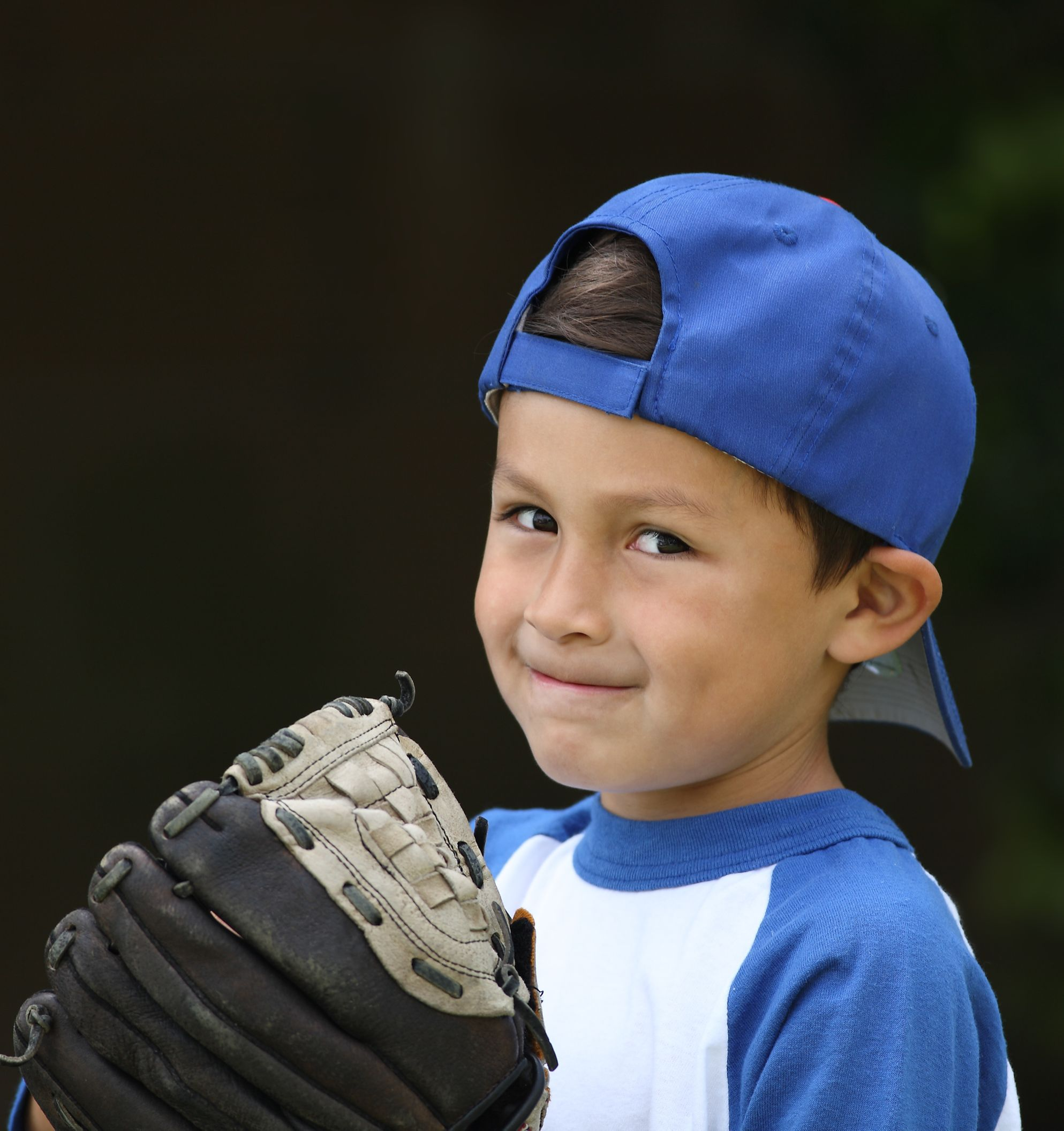 Boy with baseball glove playing competitive or lower-pressure sports.