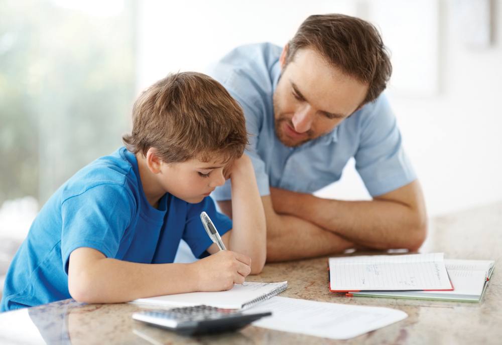dad helping son with learning disability with homework