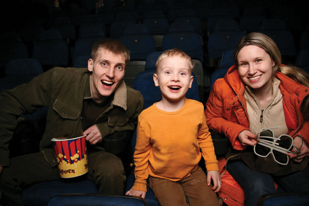 family in movie theater