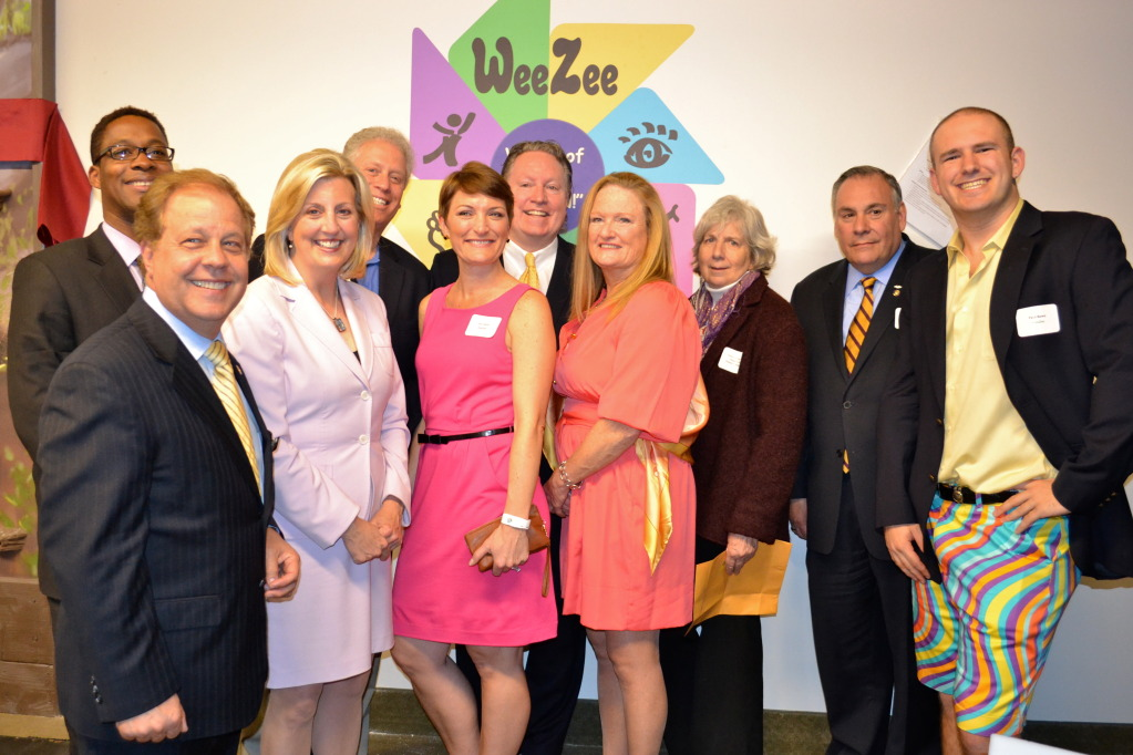 Joseph Kenner, Assistant to the County Executive at Westchester County (in back); New York State Assemblyman Thomas Abinanti; Shannon White (event Emcee) of News 12; WeeZee Executive Director of Project Development Liz Crecco; Westchester County Legislator Michael Smith; WeeZee Founder and CEO Louise Weadock; New Castle Town Supervisor Susan Carpenter; New York State Assemblyman Robert Castelli and WeeZee Manager of Research and Development Paul Rowe