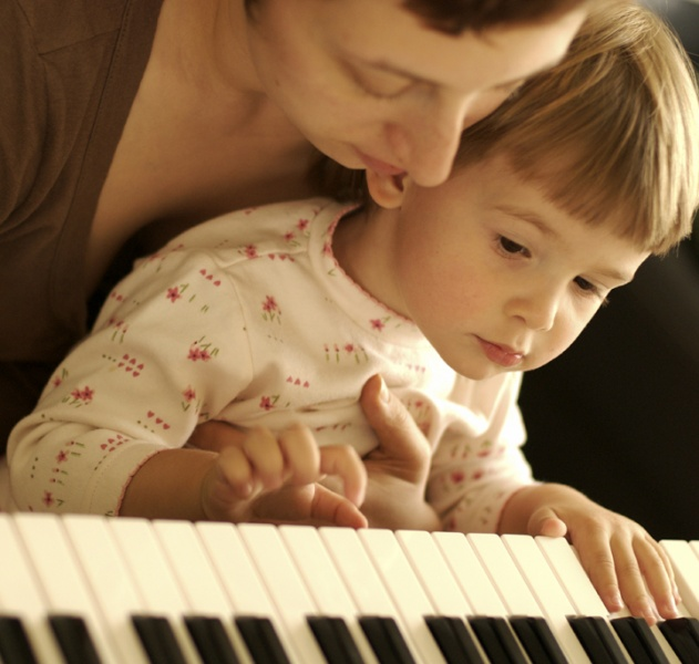Mother and child playing piano