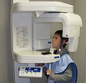 boy at dentist getting a panoramic x-ray