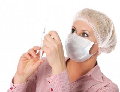 doctor prepares shot