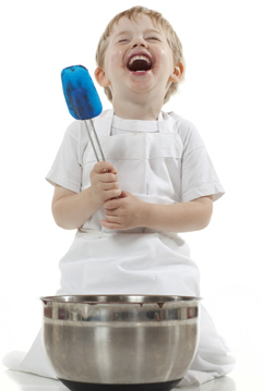 boy cooking and laughing