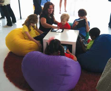 Children playing with the new Reading Rainbow iPad app at its launch