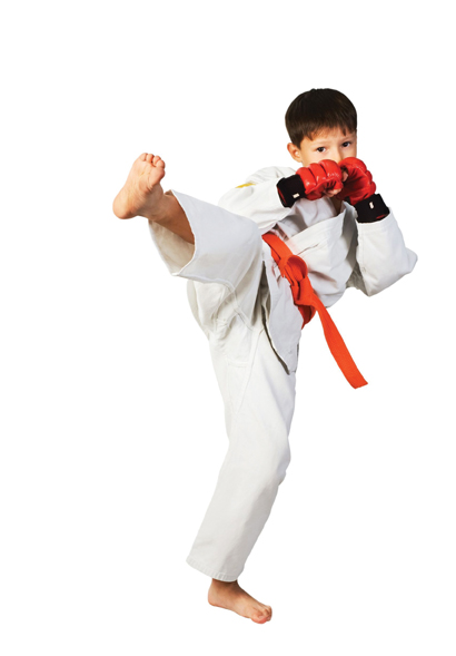 boy kickboxing wearing gloves