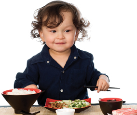 child eating Asian food