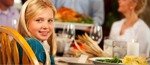 child at thanksgiving table with family