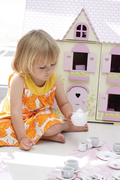 little girl playing tea party