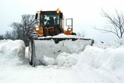 Truck Shoveling Snow