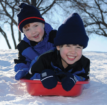 kids sledding on long island