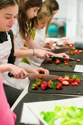 girls cooking with strawberries