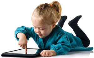 Little Child Playing with iPad Tablet