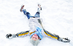 Boy Makes Snow Angel