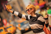 woman hailig a taxi