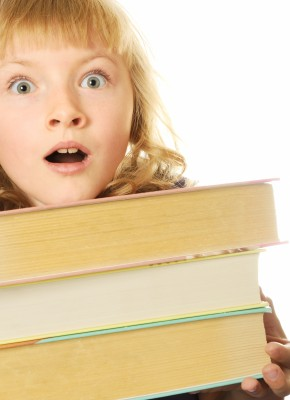 girl carrying books with a surprised look on her face