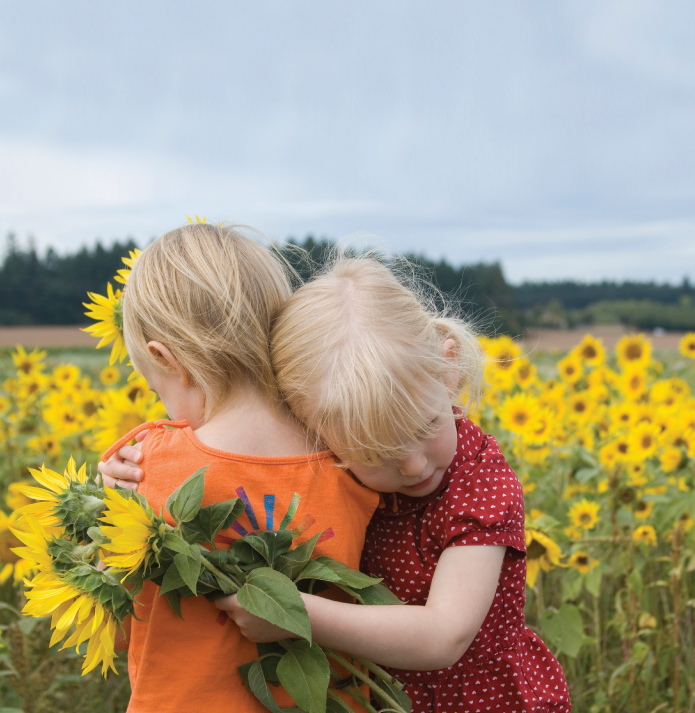 Girls in Flower Field