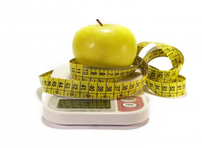 apple on scale with tape measure