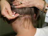 child being checked for head lice