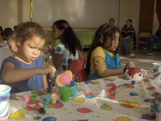 children painting figurines at chilibeans