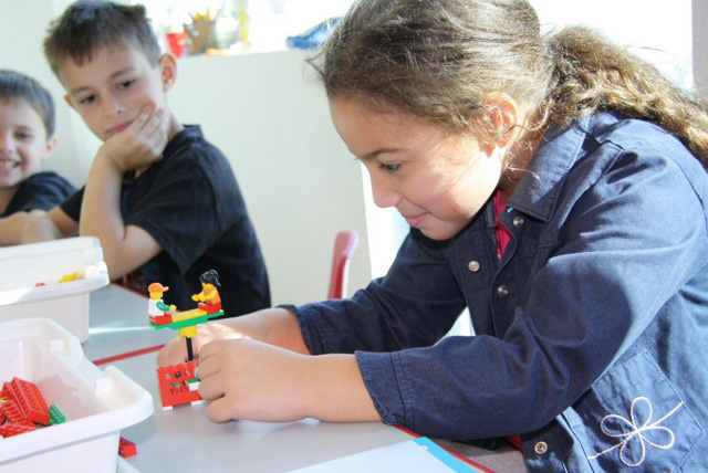 children learn physics and engineering with Legos