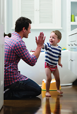 dad gives son a high five
