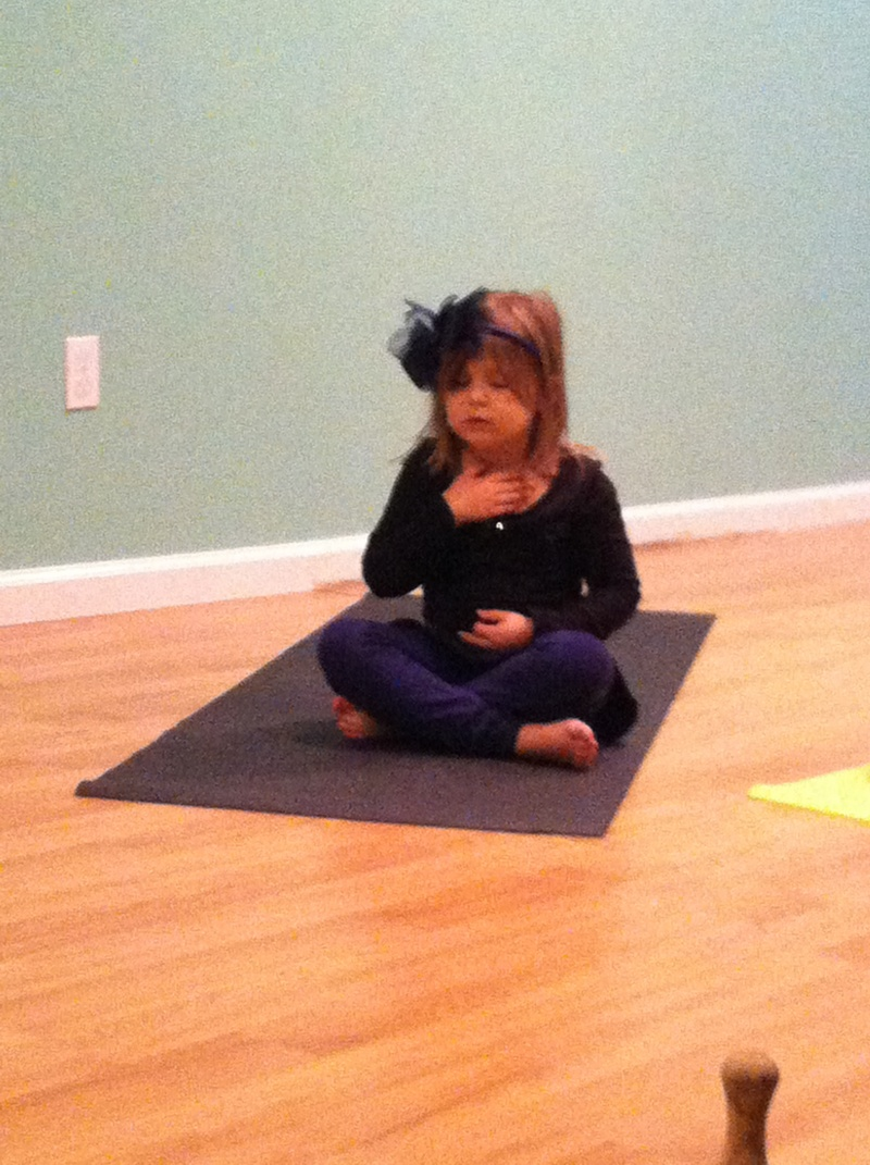 child in yoga pose