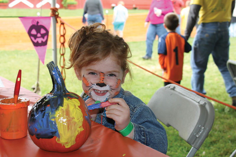 painting pumpkins at fall festival