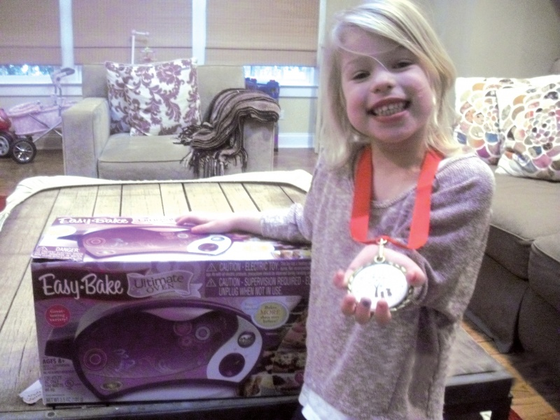 girl with easy bake oven and share your wish medal