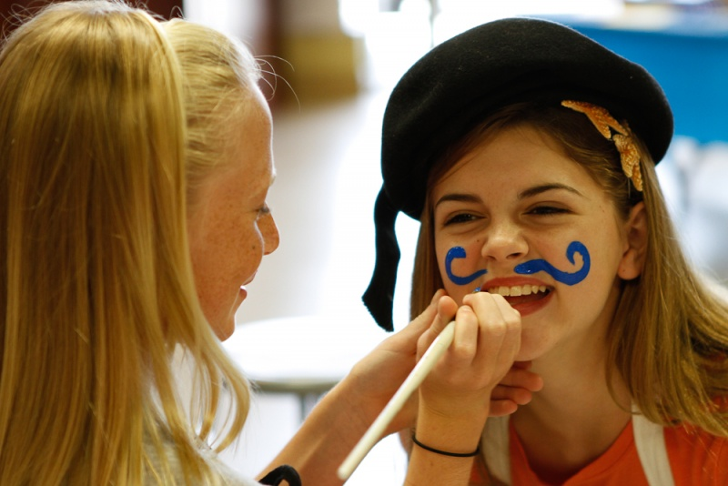 girl face painting mustache