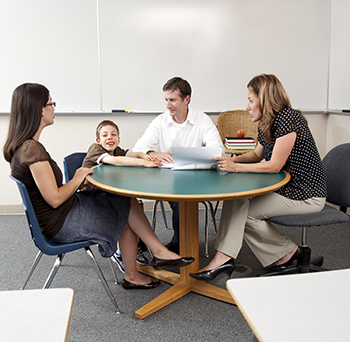 parents and child talking to teacher