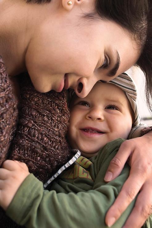 adoring mom and baby