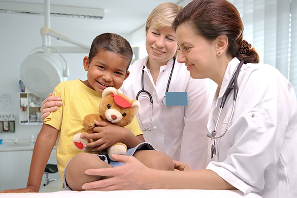 child with two doctors