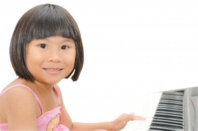 young girl playing the piano
