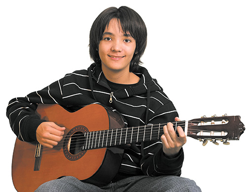 teen boy playing guitar