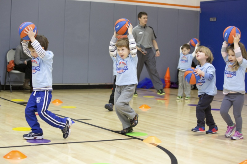 preschoolers playing basketball