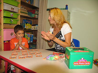 speech therapist works with child