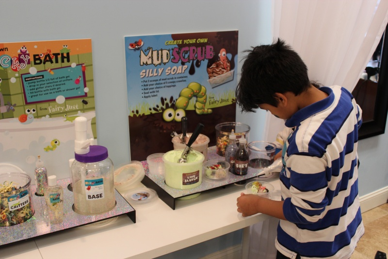 boy making mud scrub soap