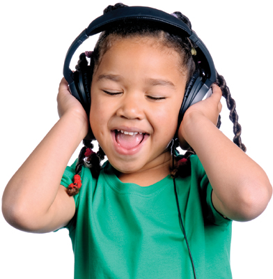 little girl singing, wearing headphones