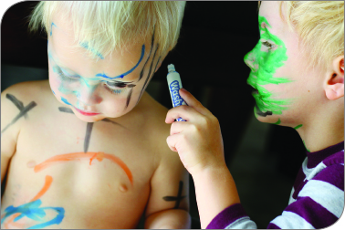 toddler with markers