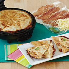 prosciutto quesadilla with tomato and basil