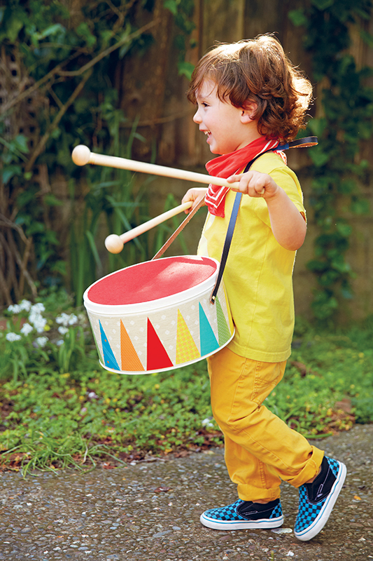 boy playing toy drum
