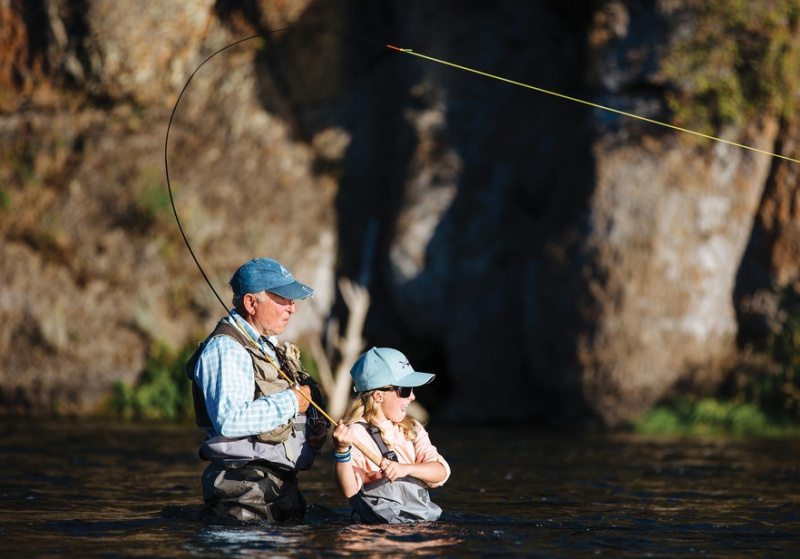 grandfather and granddaughter fly-fishing