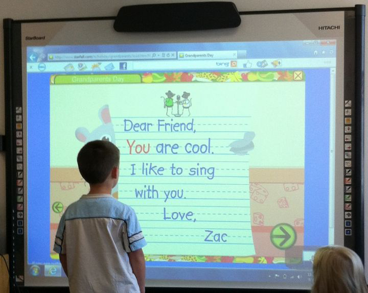 child using a smart board
