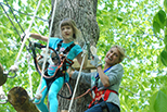 Mother and daughter climbing on ropes course