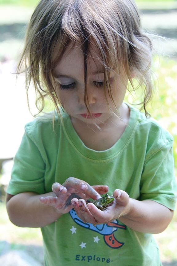 child holding frog
