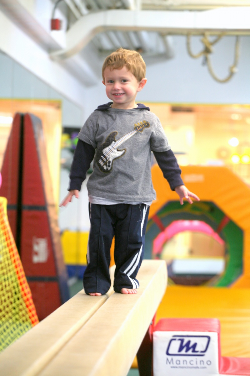 toddler boy on a balance beam