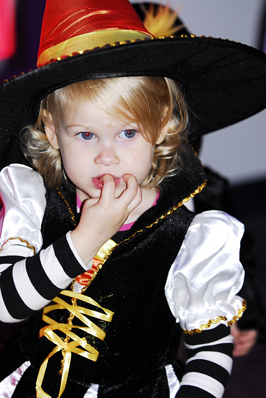 child in cute witch costume
